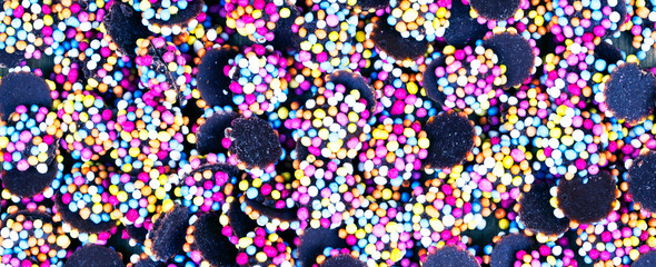 Fun food background texture - cake toppings and candy in a panorama / banner / header design.