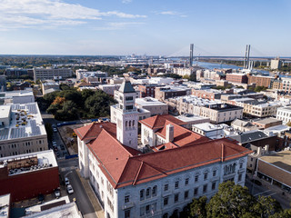 Aerial view of the downtown area of Savannah, Georgia with bridge in the distance.