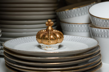 Golden crown of porcelain in the dishware