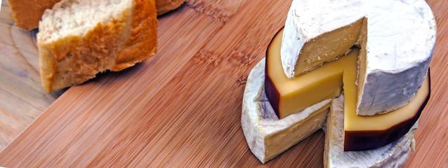 Cheese & fresh bread panorama / header / banner design - brie, smoked cheese & camembert.