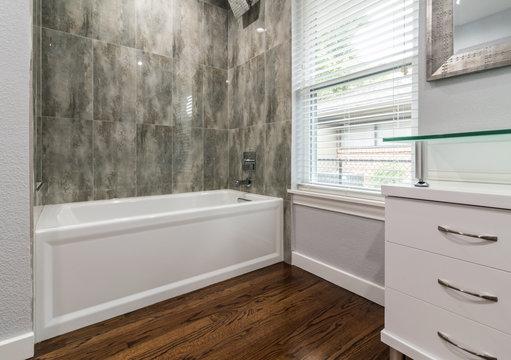 Remodeled Bathtub with Wood flooring
