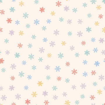 Winter seamless pattern. Christmas background with small colored snowflakes. Elegant vector texture. Festive holiday theme. Cute repeat design for kids, print, decoration, wallpaper, greeting card