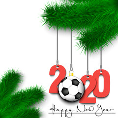 Soccer ball and 2020 on a Christmas tree branch