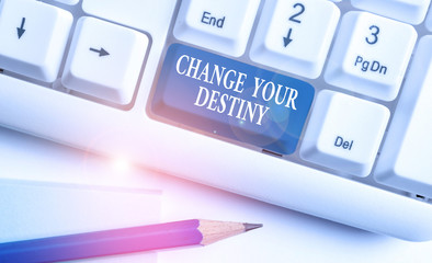 Conceptual hand writing showing Change Your Destiny. Concept meaning Rewriting Aiming Improving Start a Different Future White pc keyboard with note paper above the white background