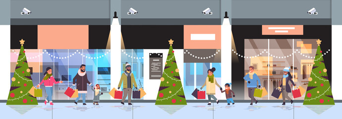 people walking with colorful paper bags merry christmas happy new year shopping concept mix race parents with children holding purchases modern mall exterior horizontal banner full length vector