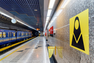 Blue train of Tehran metro. Women-only train carriage sign