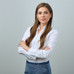 Confident business woman with crossed arms.