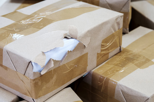 parcel with damaged packaging in the sorting center