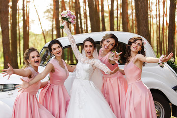 Wedding ideas. Bride and bridesmaids having fun on wedding day