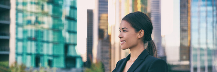 Asian business woman smiling profile portrait successful career young leader in city background...