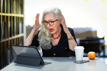 Business person stressed with anxiety due to online finances issues, identity theft, computer virus, retirement problems, or taxes