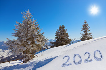 Fototapete - 2020 on snow at mountains - St. Gilgen Austria