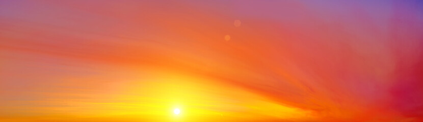 In de dag Baksteen sunset sky panorama landscape background natural color of evening landscape with yellow setting sun light coming through orange and red clouds ultra wide panoramic wallpaper cloudscape view