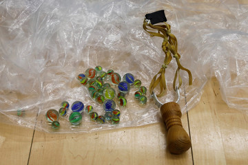 A slingshot and glass marbles left behind by anti-government protesters are pictured inside the Polytechnic University (PolyU), in Hong Kong