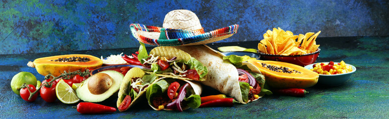 Canvas Prints Hot chili peppers Mexican food, including tacos, guacamole, nachos and pepper on rustic table