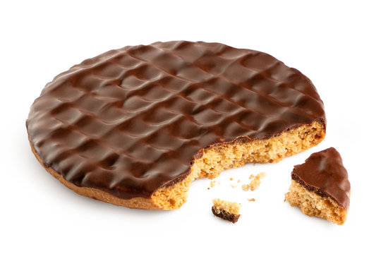 Dark chocolate coated digestive biscuit isolated on white. Partially eaten with crumbs.