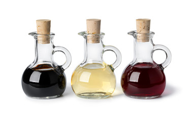 Glass bottles with different types of vinegar