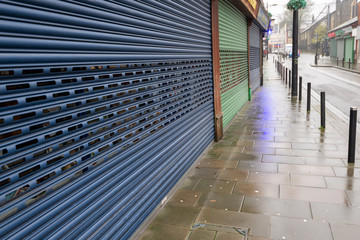 High Street Shops closing down with shutters closed, decline in shopping in Wales, United Kingdom Wall mural