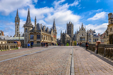 Medieval city of Gent (Ghent) in Flanders with Saint Nicholas Church and Gent Town Hall, Belgium. Sunny cityscape of Gent.