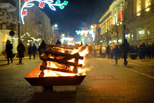 Bonfires are lit on Gediminas avenue on the night on February 16 in Vilnius, Lithuania. People attending the celebration of Restoration of the State Day.