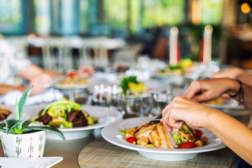 A group of people is dining in a elegance restaurant or hotel