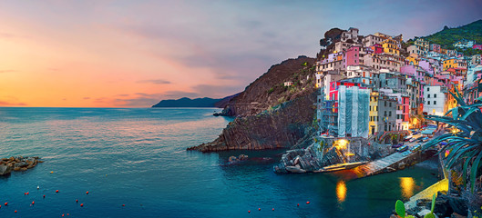Skyline view of Riomaggiore town at night. Liguria, Italy