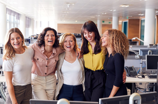 Portrait Of Smiling Female Business Team Working In Modern Office Together