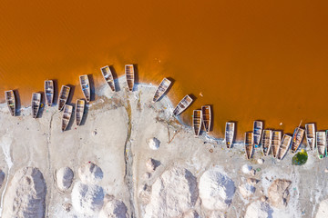 Aerial view of the Pink Lake Retba or Lac Rose in Senegal. Photo made by drone from above. Africa Natural Landscape. Fotobehang
