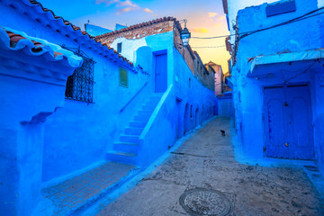 Street with blue coloured houses in old medina of Chefchaouen. Morocco,  North Africa