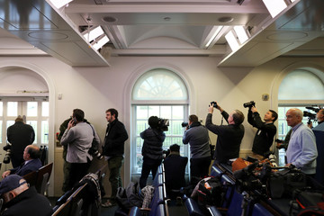 Reporters crowd the windows of the White House during a lockdown because of reports of a stray airplane over Washington