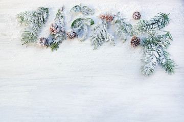 modern plain Christmas border with fir branches and snow, copy space