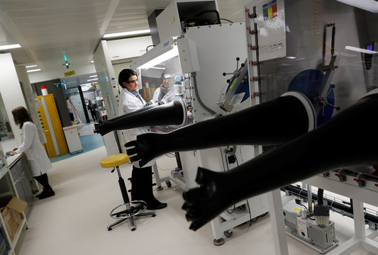 A scientist uses a molecular weighing robot during research at the GSK research centre in Stevenage