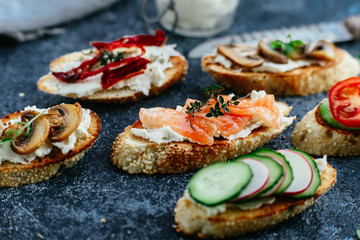 Spoed Fotobehang Voorgerecht Bruschetta with mushrooms, cucumbers, avocado, radish, salmon and egg