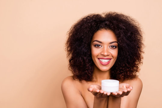 Close up photo beautiful amazing she her dark skin wavy model lady presenting promoting hold hands arms new daily facial cream advising buy buyer white teeth nude isolated beige pastel background