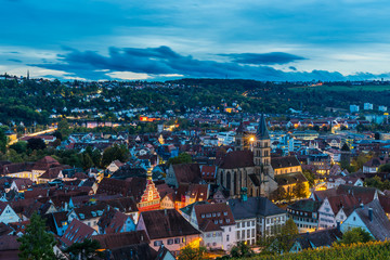 Germany, Aerial view of skyline of medieval city esslingen am neckar, roofs, houses, st dionysius church and streets illuminated at sunset in twilight mood