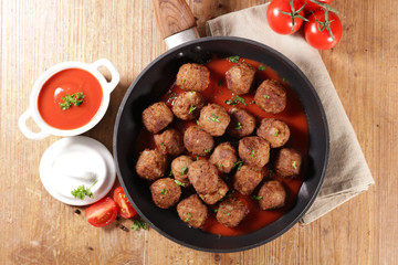 fried meatball with tomato sauce