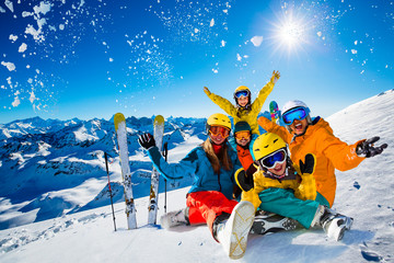 Poster Glisse hiver Happy family enjoying winter vacations in mountains. Playing with snow, Sun in high mountains. Winter holidays.