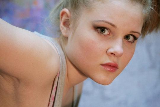 Portrait of a natural blonde. Teen girl leaned forward
