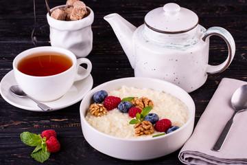 Rice porridge with fresh berries and walnuts