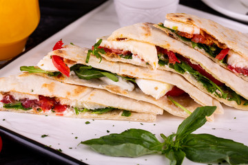 Piadina with tuna, mozzarella, red onions, tomatoes and cream cheese, served for breakfast