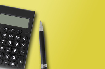 top view of pocket calculator and pen on yellow background, finance and accounting concept template