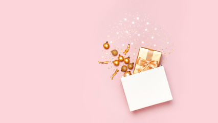 Photo sur Aluminium Roses Beautiful golden gift white paper bag confetti stars Christmas balls on pink background top view Flat lay. New Year presents Festive decorations 2020 celebration. Merry Christmas Happy Holidays card