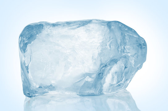 Chrystal clear frosted natural ice block in cold light blue tones on reflective surface. Clipping path included.