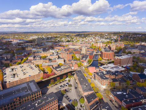 Lowell historic downtown, Canal, Marrimack River and historic Mills aerial view in fall in Lowell, Massachusetts, MA, USA.