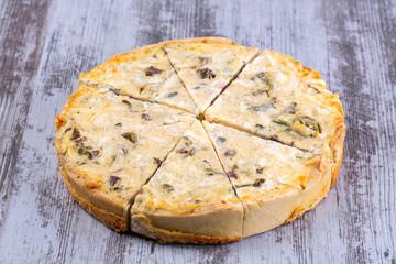 Pie with smoked beef and onion poree