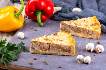 Pieces of chopped dough pies with different fillings on a wooden board