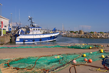 Harbor with fishing nets drying on the ground at La Turballe, a commune in the Loire-Atlantique department in western France.