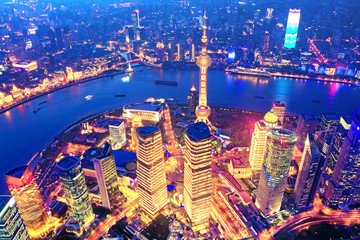 Wall Murals Shanghai Aerial view of the Shanghai city skyline overlooking Pudong Financial District and Huangpu River at night from the Shanghai Tower. China.