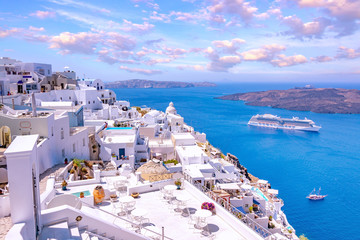 Beautiful Thira town on Santorini island, Greece. Traditional white architecture over the Caldera in Aegean sea. Scenic travel background.