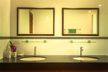 Double mirror and double basin in bathroom